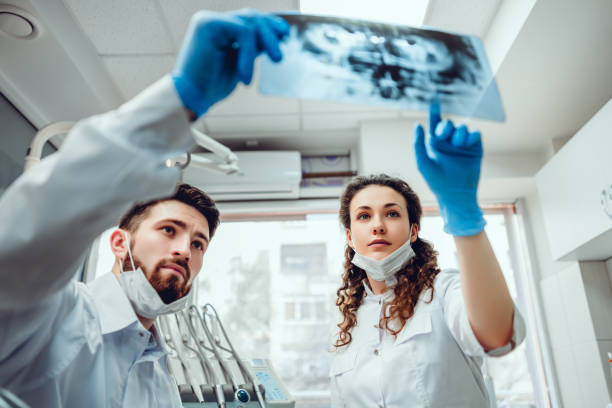 Healthcare and medicine concept. Healthcare, medical and radiology concept - two dentist doctors looking at x-ray. selective focus. dental health stock pictures, royalty-free photos & images