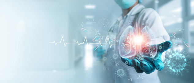 Healthcare and medicine, Covid-19, Doctor holding and diagnose  virtual Human Lungs with coronavirus spread inside on modern interface screen on hospital background, Innovation and Medical technology.