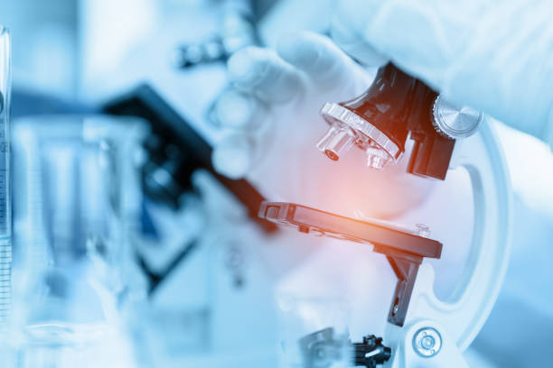 Healthcare and medicine Close Up Scientist using microscope in laboratory room while making medical testing and research laboratory stock pictures, royalty-free photos & images