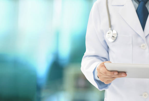 healthcare and medicine healthcare and medicine technology concept. doctor or medical students using digital tablet at hospital ward. doctors office stock pictures, royalty-free photos & images