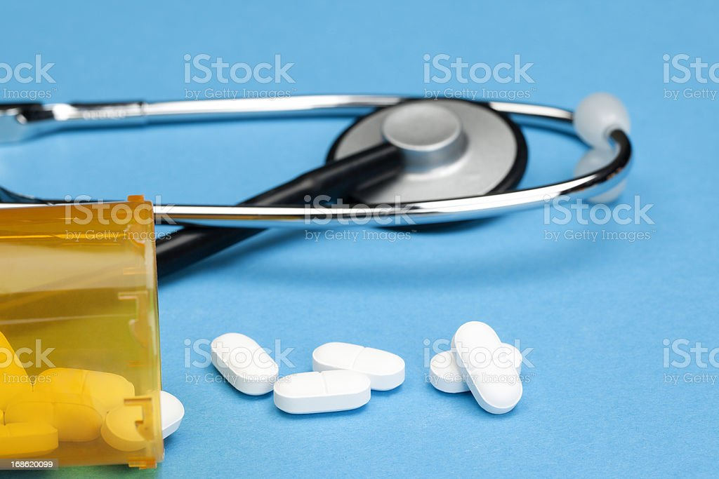 Healthcare and Medicine: Pill Bottle with a Stethoscope royalty-free stock photo