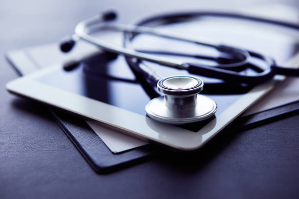 Healthcare and technology concept, tablet and stethoscope stock photo