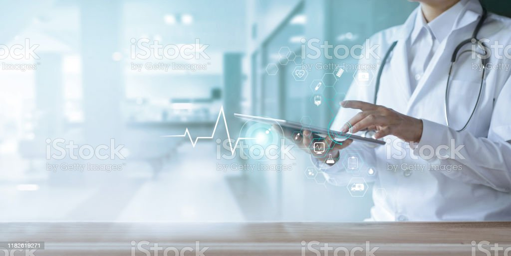 Healthcare and technology, Doctor using digital tablet with icon medical network on hospital background - Стоковые фото Аварии и катастрофы роялти-фри