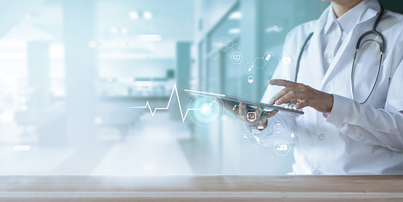 927897070 istock photo Healthcare and technology, Doctor using digital tablet with icon medical network on hospital background 1182619271