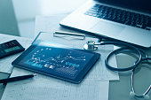 istock Healthcare business concept, Medical examination and growth graph data of business on tablet with doctor's health report clipboard on background. 1274428125