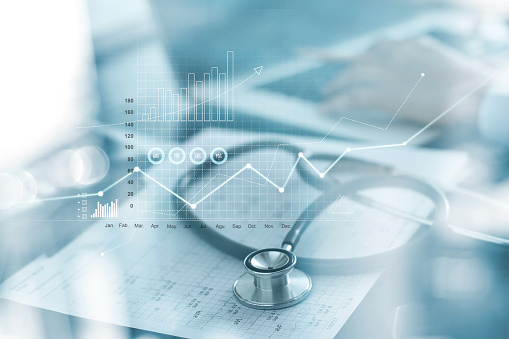 istock Healthcare business graph and Medical examination and businessman analyzing data and growth chart on blured background 1165046681