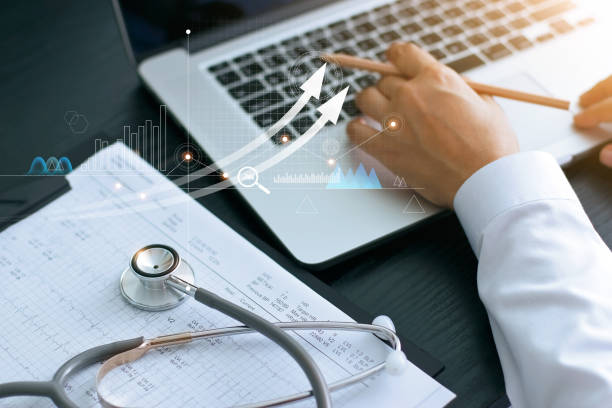 Healthcare business graph and Medical examination and businessman analyzing data and growth chart on laptop background stock photo
