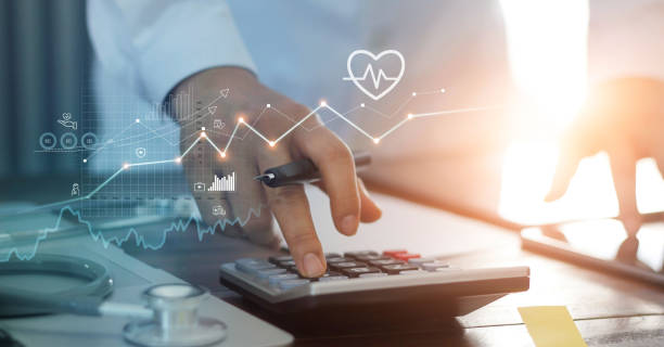 Healthcare business graph data and growth, Doctor use calculator and calculate healthcare costs and analyzing medical report on tablet. stock photo
