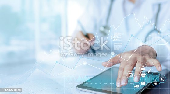 istock Healthcare business graph data and growth, Medical examination and doctor analyzing medical report network connection on tablet screen. 1185375169