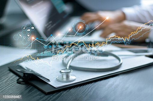 istock Healthcare business graph data and growth, Stethoscope with doctor's health report clipboard on table, Medical examination and doctor analyzing medical report on laptop screen. 1220059467