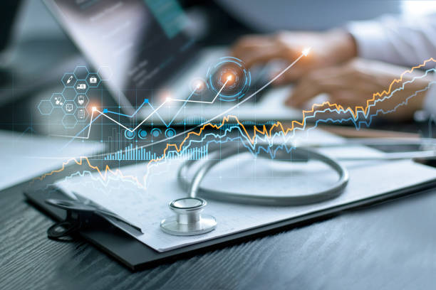 Healthcare business graph data and growth, Stethoscope with doctor's health report clipboard on table, Medical examination and doctor analyzing medical report on laptop screen. Healthcare business graph data and growth, Stethoscope with doctor's health report clipboard on table, Medical examination and doctor analyzing medical report on laptop screen. healthcare and medicine stock pictures, royalty-free photos & images
