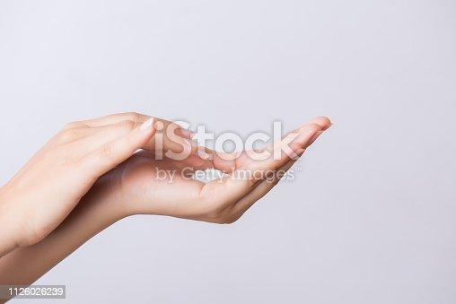 istock Healthcare concept. Closeup shot of  young woman hands applying moisturizing hand cream. 1126026239