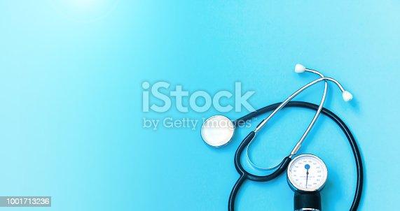 Medical concept background. Stethoscope on doctor blue.