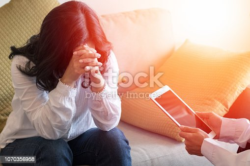 istock Healthcare concept of professional psychologist doctor consult in psychotherapy session or counsel diagnosis health. 1070356958