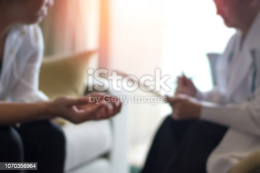 istock Healthcare concept of professional psychologist doctor consult in psychotherapy session or counsel diagnosis health. 1070356964