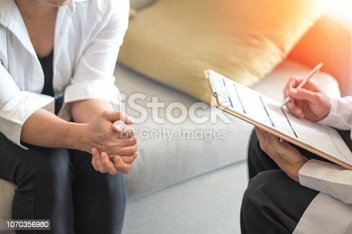 istock Healthcare concept of professional psychologist doctor consult in psychotherapy session or counsel diagnosis health. 1070356980