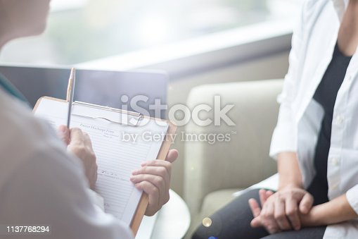 istock Healthcare concept of professional psychologist doctor consult in psychotherapy session or counsel diagnosis health. Major depressive disorder patient (MDD) with physician. 1137768294