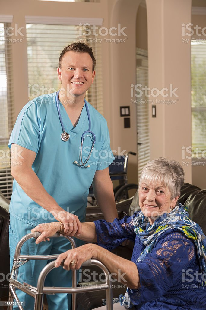 Concierge doctor service. Doctor makes home visit to senior woman at...