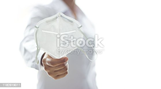 istock Healthcare, Medical and Medicine, Young woman holding mask of flu protection and the upcoming flu season on white background. 1182619011