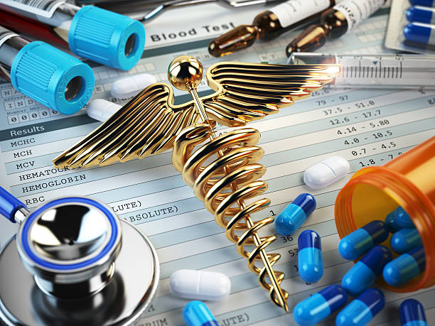 healthcare medical concept. pills, capsules, stethoscope, syring - caduceus stock pictures, royalty-free photos & images