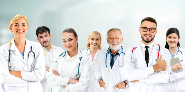Healthcare people group. Professional doctor working in hospital office or clinic with other doctors, nurse and surgeon. Medical technology research institute and doctor staff service concept. stock photo
