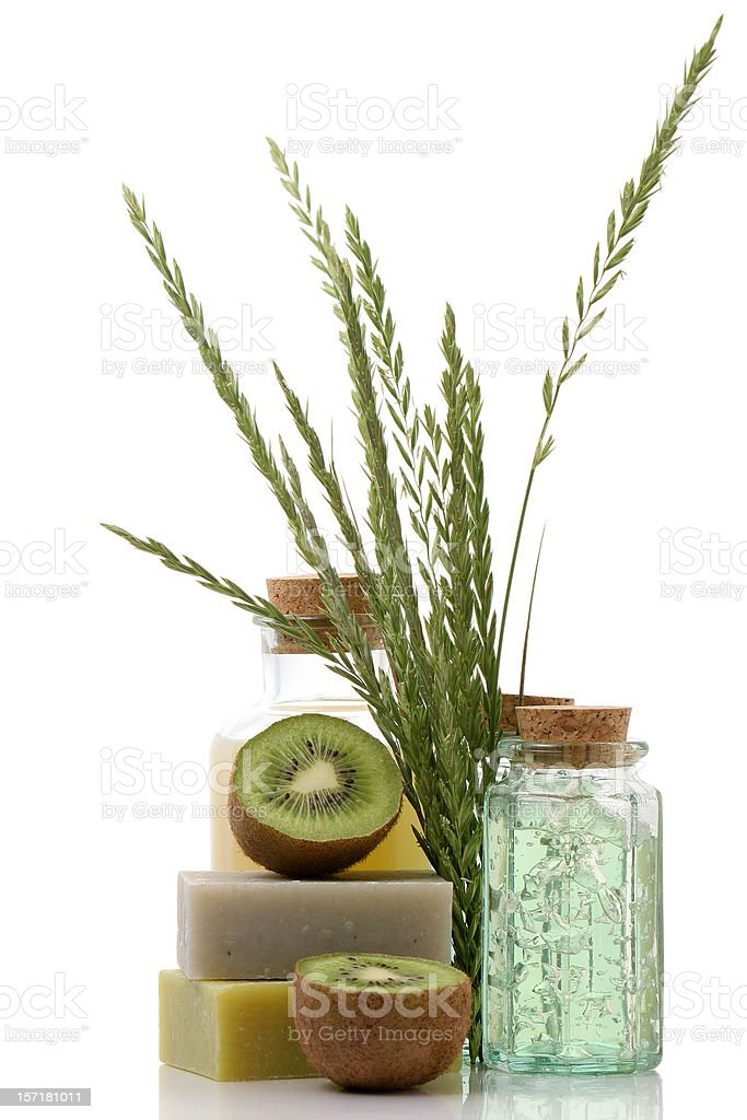 Healthcare products in bottles with cork and soap bars royalty-free stock photo