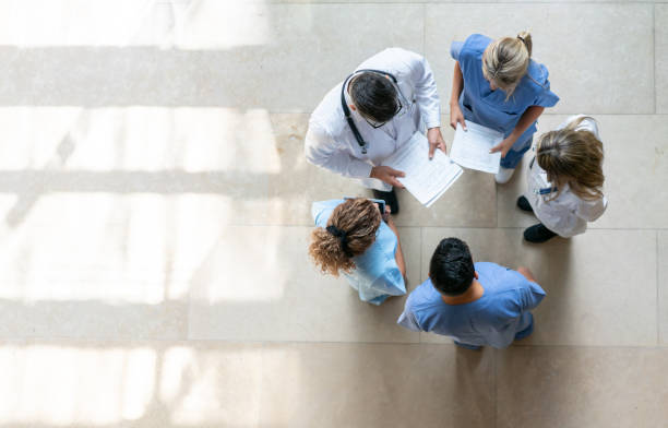 Healthcare professionals during a meeting at the hospital Healthcare professionals during a meeting at the hospital - High angle view healthcare and medicine stock pictures, royalty-free photos & images
