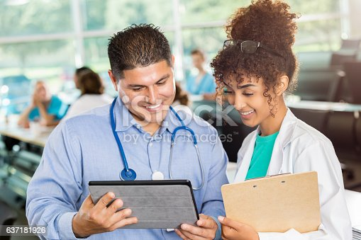 istock Healthcare professionals review digital patient file 637181926