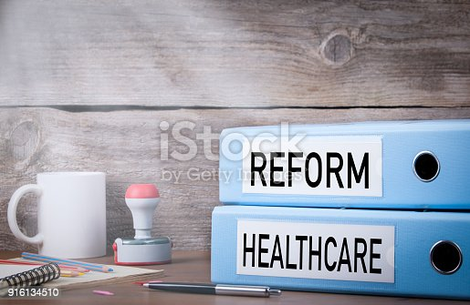 istock Healthcare Reform. Two binders on desk in the office 916134510