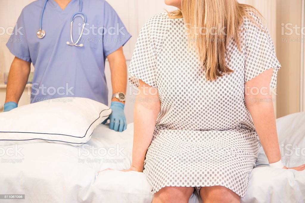 Healthcare: Woman in doctor's office for annual check up. stock photo