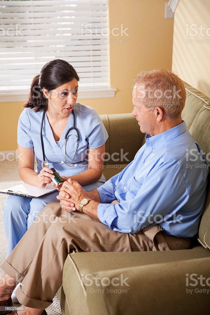 Healthcare worker advising patient on prescription medicine royalty-free stock photo