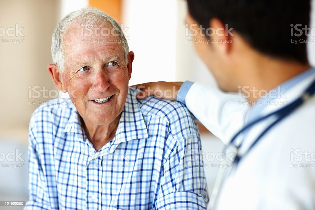 Healthcare worker and elderly patient stock photo