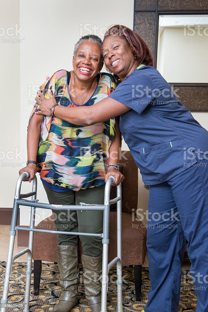 Healthcare Worker and Senior Woman Share a Victory stock photo