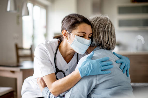 Healthcare worker at home visit stock photo