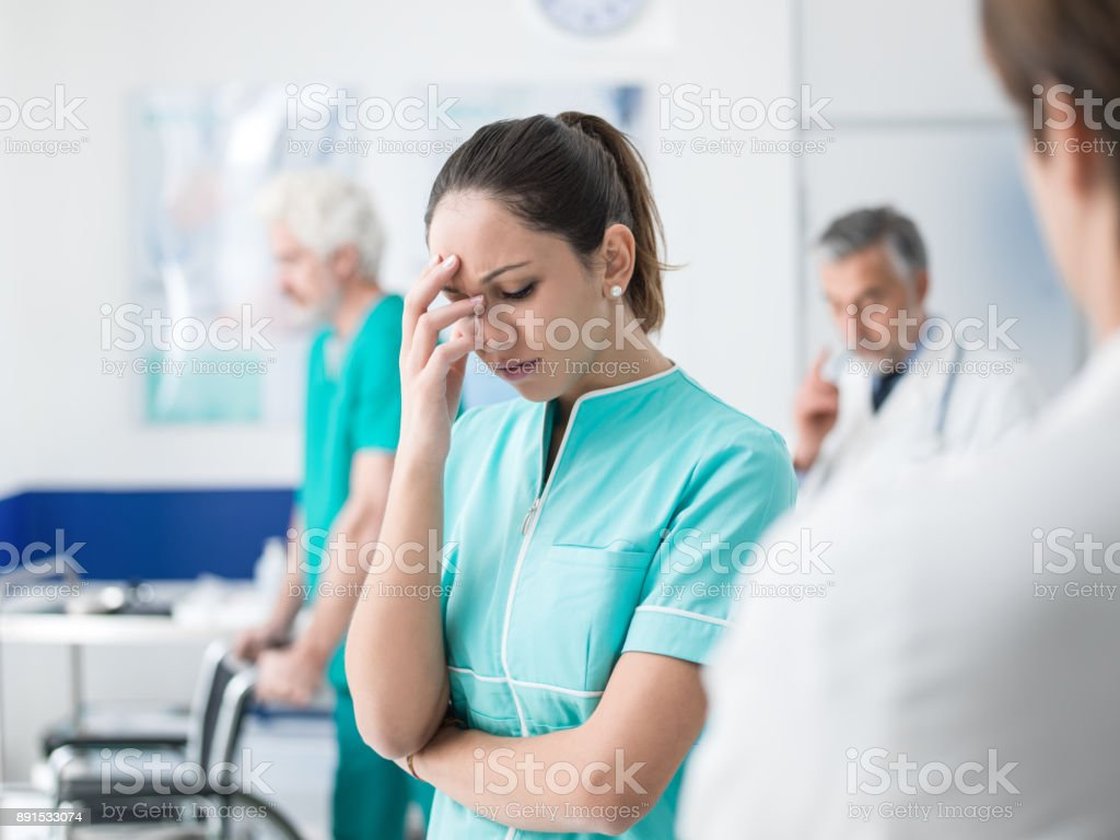 Healthcare worker having an headache stock photo