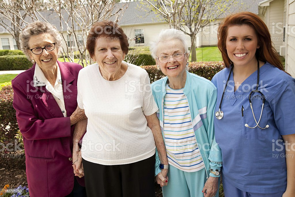 Healthcare Worker with a Happy Group of Senior Adults royalty-free stock photo