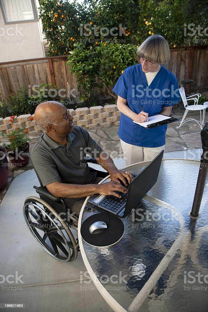 Healthcare worker with disabled senior stock photo