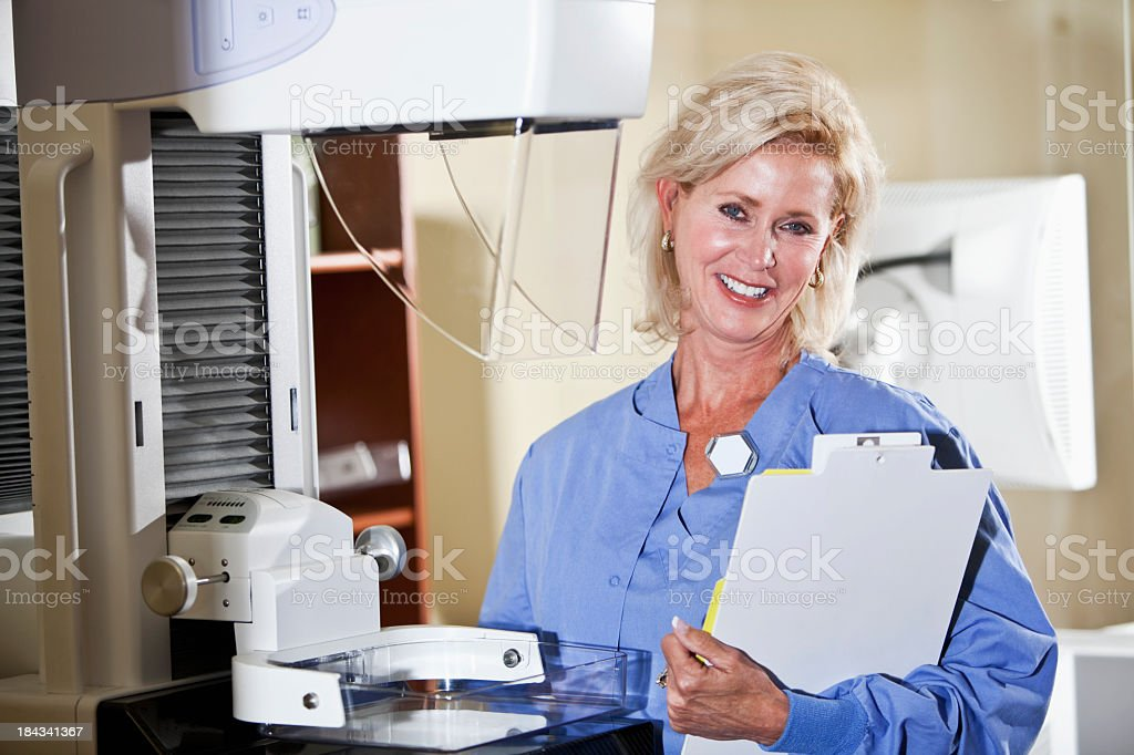 Healthcare worker with mammography scanner stock photo
