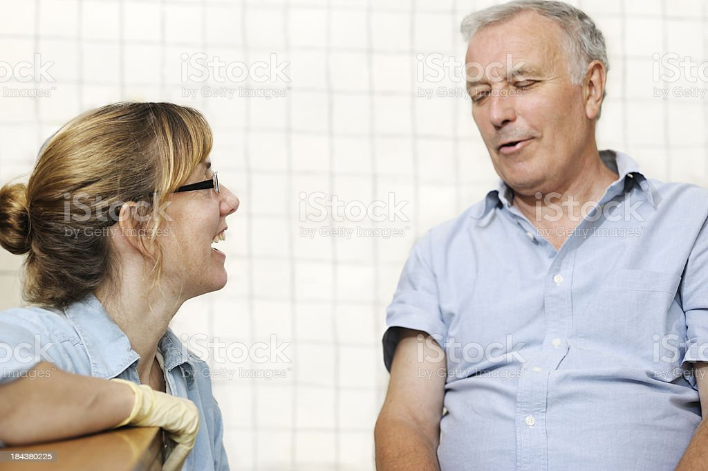 Healthcare worker with senior patient royalty-free stock photo