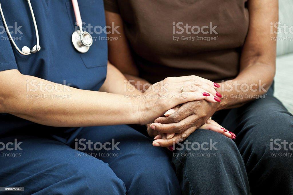 Healthcare Worker's Comforting Hands stock photo