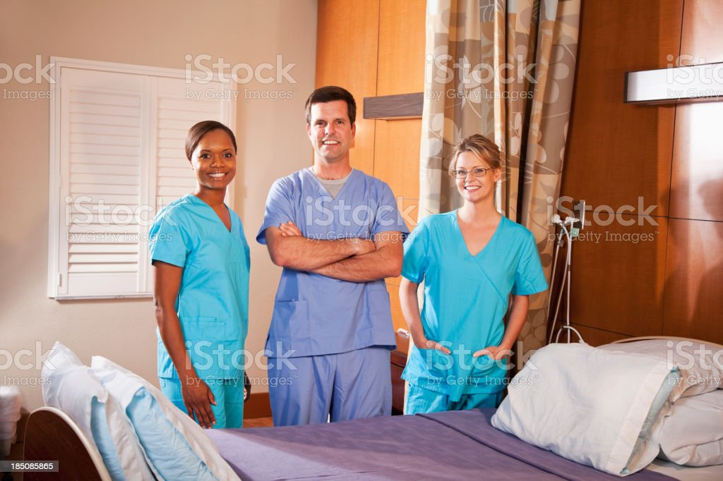 Healthcare workers in hospital room stock photo