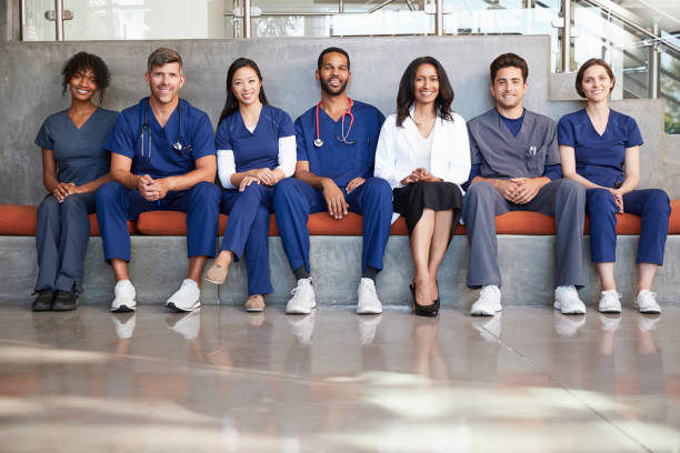 healthcare workers sitting in a modern hospital, low angle - doctors and nurses stock photos and pictures