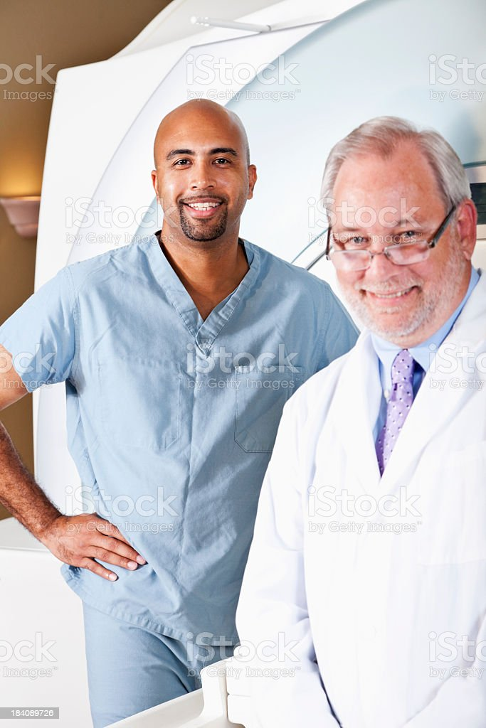 Healthcare workers with MRI scanner stock photo