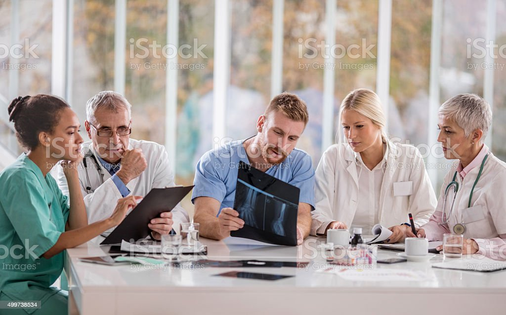 Healthcare workers working on a meeting in the hospital. stock photo