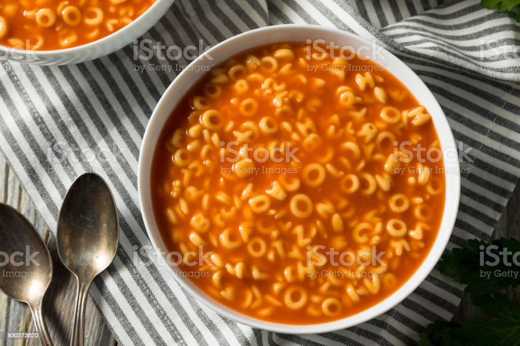 Healthy Alphabet Soup in Tomato Sauce stock photo