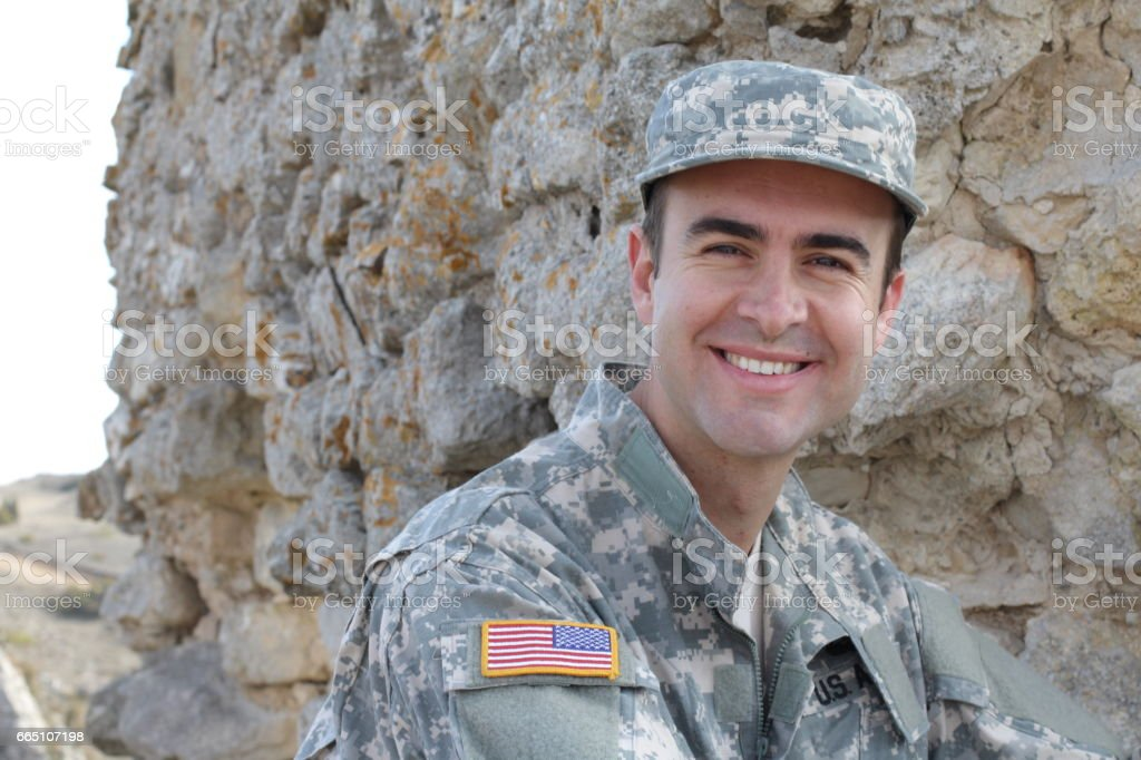 Healthy American soldier smiling outdoors stock photo