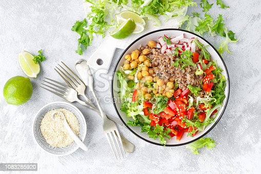 istock Healthy and delicious bowl with buckwheat and salad of chickpea, fresh pepper and lettuce leaves. Dietary balanced plant-based food. Vegan and vegetarian dish. Top view. Flat lay 1083285920