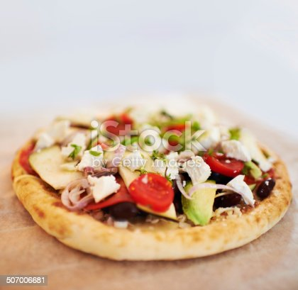 A tasty pita bread topped with a range of fresh ingredients