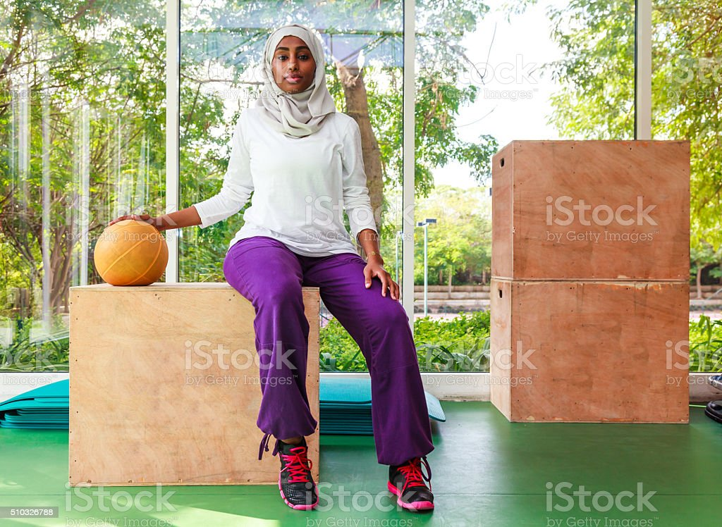 healthy and happy African Muslim woman stock photo
