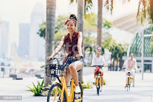Group of young women riding bicycles in the city